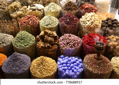 Colorful spices and herbs selection at Dubai Spice Souk.