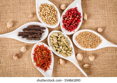 colorful spices on sack background.