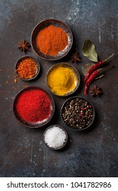 Colorful spices on stone table. Top view