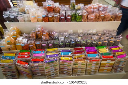 Colorful spices in plastic bags on display for sale, market in Thailand