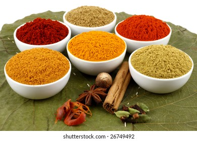 colorful spices powders on dried leaves