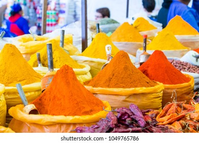 Colorful spices pyramids background. Sucre traditional market, Bolivia.