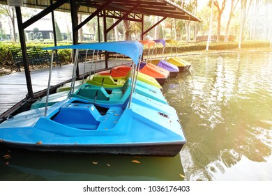 Colorful spinning boat in a big pond at Thailand.