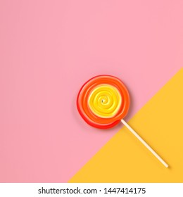 Colorful spiral lolipop on pastel color background.sweet candy concept