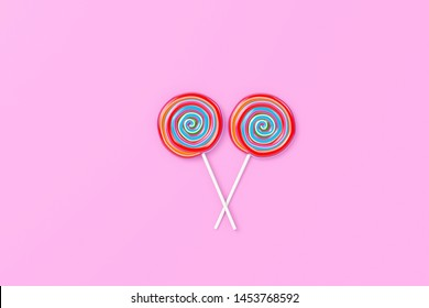 Colorful spiral lolipop on pink pastel color background.sweet candy concept