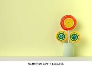 Colorful spiral lolipop on yellow pastel color background.sweet candy concept
