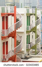 Colorful spiral staircases at the back of traditional Chinese shop houses in Bugis Village, Singapore. Colorful urban and cityscape concept