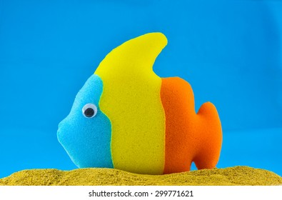 Colorful Sponge fish and sand in blue background