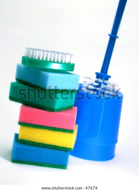 Colorful sponges, a hand scrubber, and a toilet bowl scrubber.