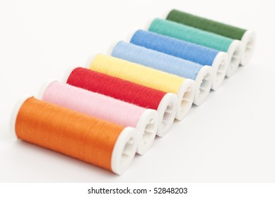 Colorful Spools of sewing thread.
