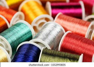 colorful spools of thread, vivid colors, shallow dof