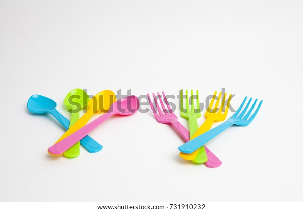 Colorful spoons on white background