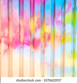 Colorful spray painted graffiti closeups on an urban textured wall.