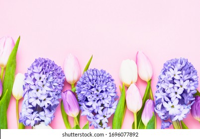 Colorful spring flowers on pink background. Mothers day, Valentines Day, Birthday celebration concept. Top view, copy space for text