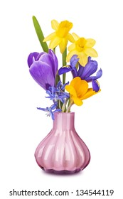Colorful spring flowers in a vase isolated on white background