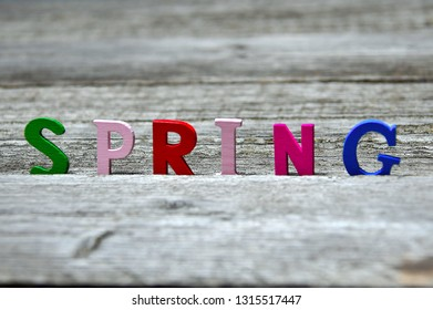 colorful spring inscription on old wooden board