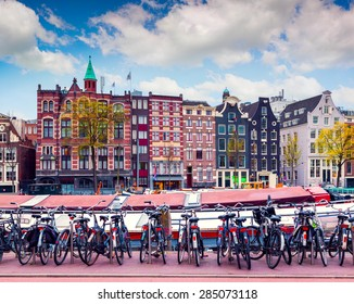Colorful spring morning in the Amsterdam. Authentic Dutch architecture in the capital and most populous city of the Netherlands.