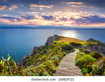 Colorful spring sunset on the cape Milazzo, nature reserve Piscina di Venere, Sicily, Italy, Tyrrhenian sea, Europe.