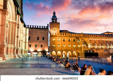 Colorful spring sunset on the main square of City of Bologna with Palazzo d'Accursio and facade of Basilica di San Petronio. Great cityscape of Bologna, Italy, Europe. Traveling concept background.