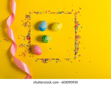 Colorful sprinkles on a yellow background