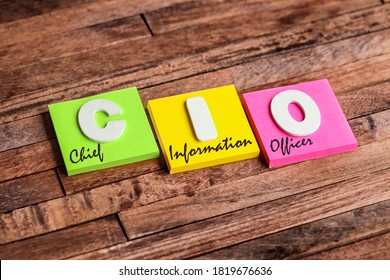 Colorful square papers with wooden white letters for the acronym word CIO means Chief Information Officer