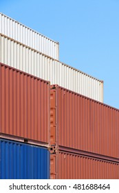 Colorful stack of container shipping at dockyard