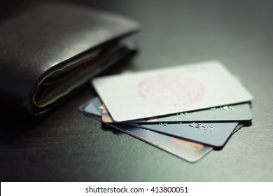 Colorful stack of credit cards and shopping gift cards  with wallet on gray carpet back ground. Extremely shallow dof.