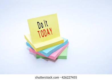 Colorful stack of sticky note isolated on white background with words Do It TODAY.
