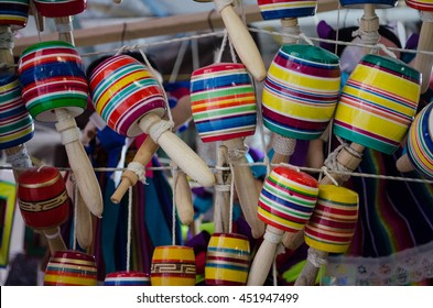 A colorful stack of traditional mexican toys