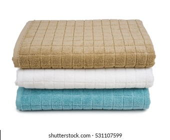 Colorful stacked bath towels isolated on white background.