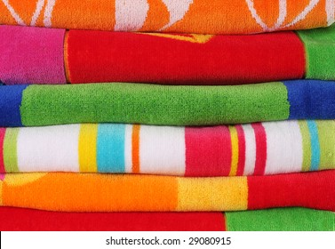 Colorful stacked beach towels.