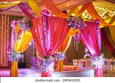 The colorful stage decoration with bright shade of color for bride and groom in the sangeet night of traditional indian wedding