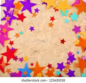 colorful stars on old vintage paper background