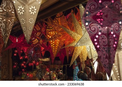 Colorful star-shaped lanterns at winter Christmas market in Basel, Switzerland