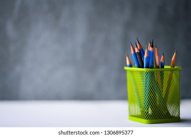 Colorful stationery on dark background.