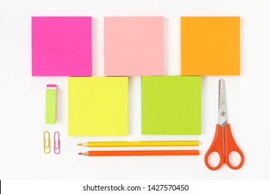 Colorful stationery set as border on white background. Top view, flat lay.