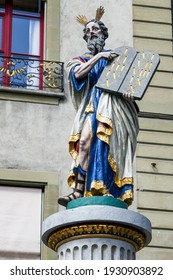 Colorful statue of Moses on the Moses Fountain (Mosesbrunnen; 1544 AD) on the forecourt of the Münster Cathedral in Bern.
