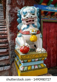 Colorful statue of snow lion in the monastery yard during the ritual kora (yatra) around sacred Mount Kailash. Sacred place for Buddha pupils making piligrimage in Asia. Place of prayer and meditation