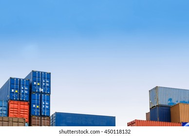 The colorful steel containers are stacking in the logistic hub on the blue sky background
