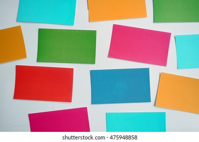 Colorful sticky note on white background. Blank paper note.