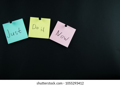 colorful sticky notes on the black background