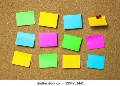 Colorful sticky notes or post it paper on the bulletin wall board