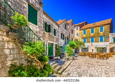 Colorful stone architecture at 2400 years old square in old town Stari Grad (Pharos) Island Hvar scenery, Croatia. / Selective focus.