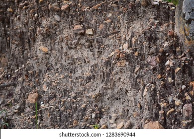 Colorful stone background A rock mixed with soil