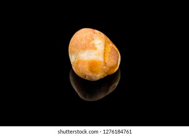 Colorful stone with different designs and colors and black background