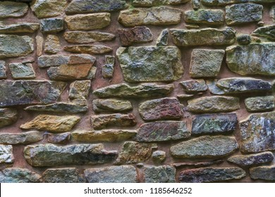 Colorful stone texture background; blank rock wall sign