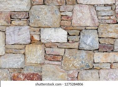 colorful stone wall close up, seamless pattern background