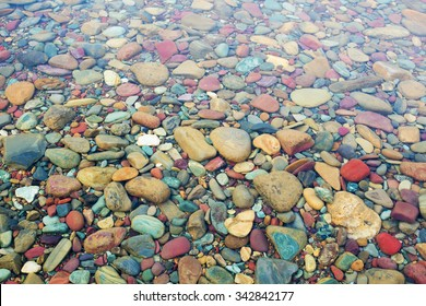 Colorful stones under the clear water of Lake McDonald. Glacier National Park, Montana