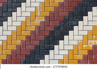 colorful stones used in the sidewalks and gardens of buildings in today's architecture and their aesthetics in the landscape