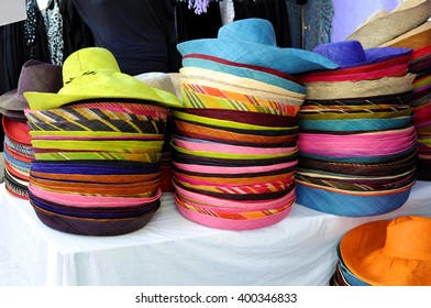 Colorful straw hats in market stall